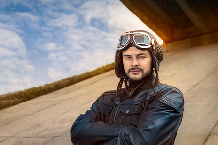 model airplane: Retro Pilot Portrait with Glasses and Vintage Helmet