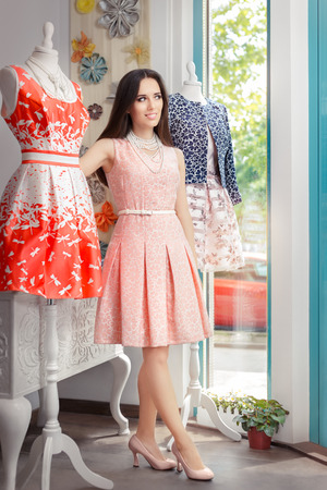 crafty: Woman in Pink Dress in Fashion Store Stock Photo