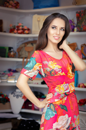 personal shopper: Woman in Red Floral Dress in Fashion Store