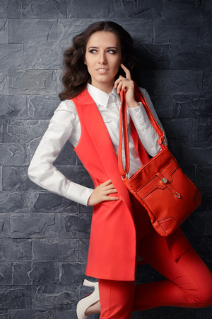 Business Woman in Smart Office Outfit with Matching Handbag