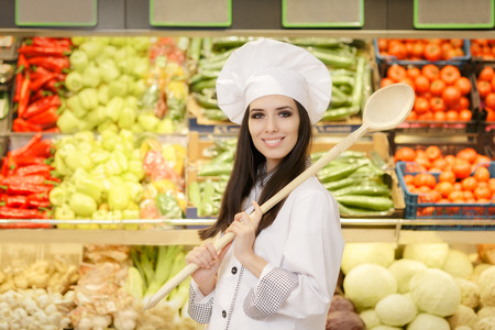 local supply: Happy Lady Chef with Big Spoon Shopping for Vegetables Stock Photo