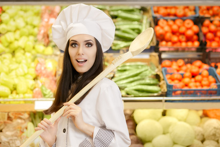 local supply: Funny Lady Chef with Big Spoon Shopping for Vegetables