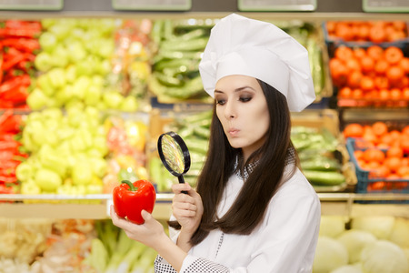 red food: Funny Lady Chef Inspecting Vegetables with Magnifying Glass