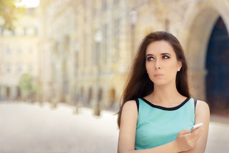 Undecided Woman with Smartphone out in the City