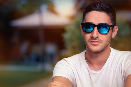 Man Wearing Sunglasses Waiting in a Restaurant
