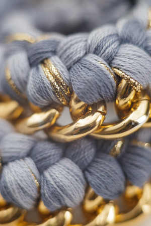 opulent: Details of a Chain and Wool Jewelry Necklace