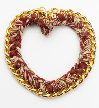 opulent: Heart Shape Chain and Wool Jewelry Necklace Stock Photo
