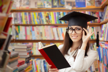 bookish: Female School Student Reading a Book in a Library