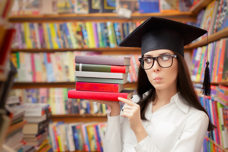 bookish: Surprised  Student with Graduation Cap Holding Books