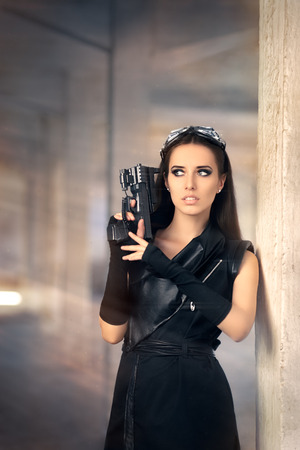 rebelling: Steampunk Female Warrior with Gun in Post Apocalyptic Ruins Stock Photo