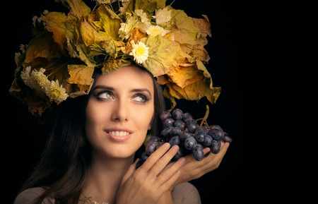 female beauty: Autumn Woman Beauty Portrait with Grape Stock Photo