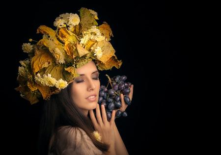 flower leaf: Autumn Woman Beauty Portrait with Grape Stock Photo
