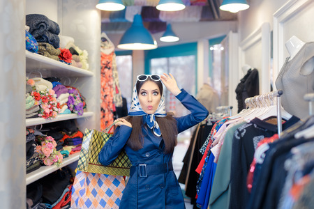 Curious Girl in Blue Trench Coat and Sunglasses Shopping