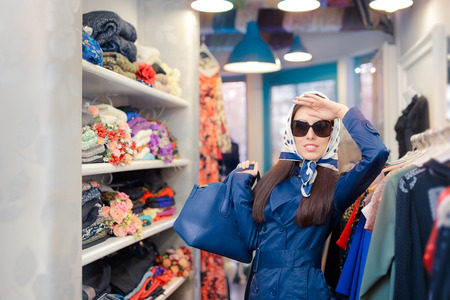 trench coat: Happy Girl in Blue Trench Coat and Sunglasses Shopping