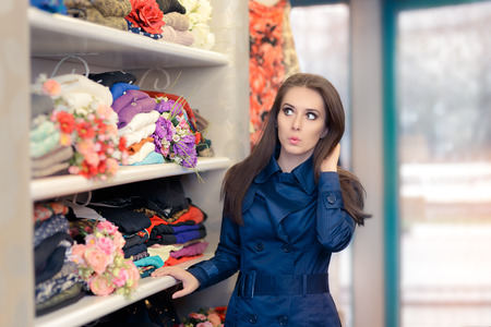 trench coat: Surprised  Girl in Blue Trench Coat Shopping Stock Photo
