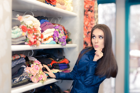 trench: Surprised  Girl in Blue Trench Coat Shopping Stock Photo