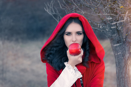 good and bad: Red Hooded Woman Holding Apple Fairytale Portrait