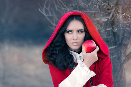 Red Hooded Woman Holding Apple Fairytale Portrait Фото со стока - 44414731