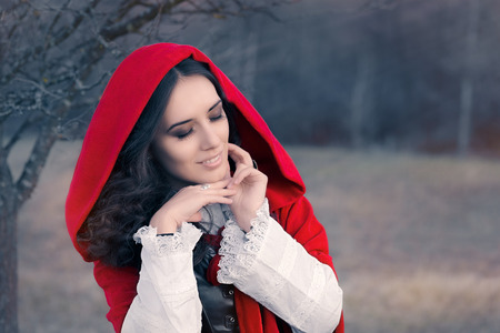 glamour woman: Red Hooded Woman Fairytale Portrait Stock Photo