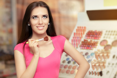 promoter: Happy Woman Holding a Make-up Brush Stock Photo