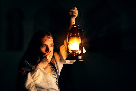 historical: Scared Medieval Princess Holding Lantern