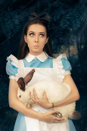 lewis carroll: Funny Girl Costumed as Alice in Wonderland with The White Rabbit