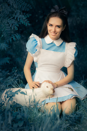 Girl Costumed as Alice in Wonderland with The White Rabbit