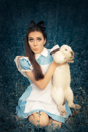 utopia: Funny Girl Costumed as Alice in Wonderland with The White Rabbit