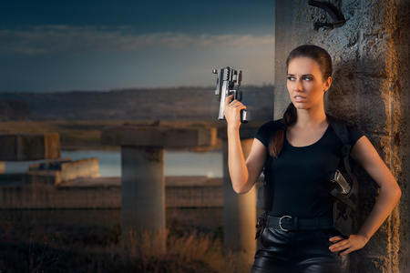 spy girl: Powerful Woman Holding Gun Action Movie Style