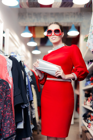 red purse: Woman wearing red dress in fashion store