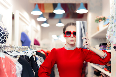 spender: Funny fashion woman in red dress with big glasses and shinny bag