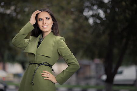 young girls nature: Woman in Green Jacket Outside Stock Photo