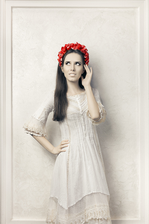 high spirits: Woman in Vintage Style White Dress and Floral Wreath Stock Photo