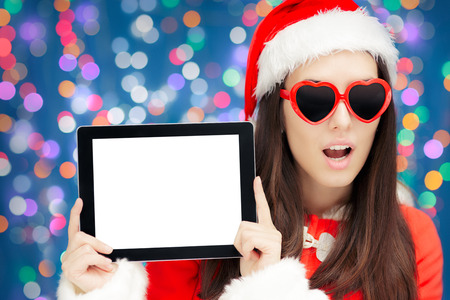 holiday lights display: Surprised Christmas Girl with Heart Sunglasses and Tablet Stock Photo