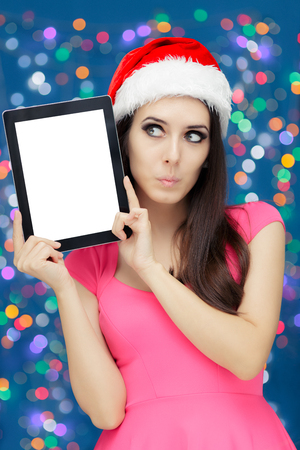 expressive: Surprised Christmas Girl with Tablet