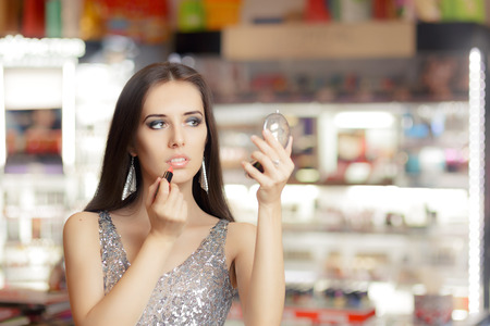 beauty shop: Glamour Woman with Lipstick and Make-up mirror Stock Photo