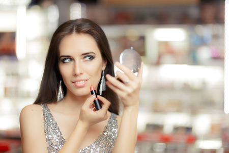 on mirrors: Glamour Woman with Lipstick and Make-up mirror Stock Photo