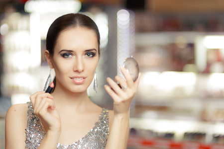 flawless: Glamour Woman with Lipstick and Make-up mirror Stock Photo