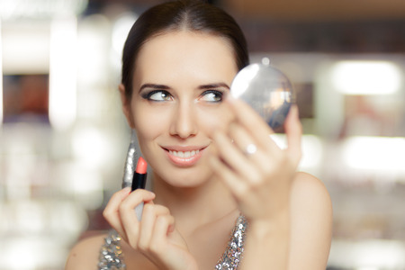 eye shade: Glamour Woman with Lipstick and Make-up mirror Stock Photo