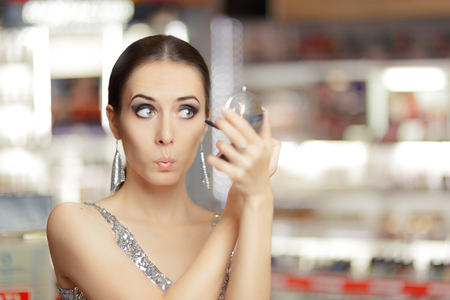 mirror: Surprised Woman with Mascara and Make-up mirror