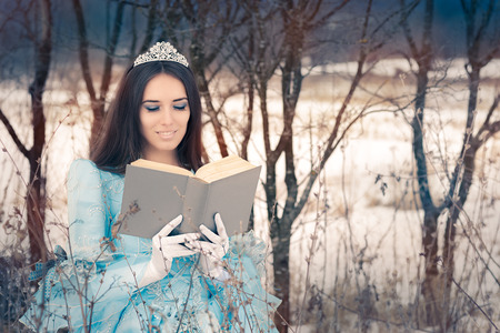 Beautiful Snow Queen Reading a Book Stock Photo