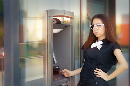 deposit: Stressed Woman with credit card at ATM