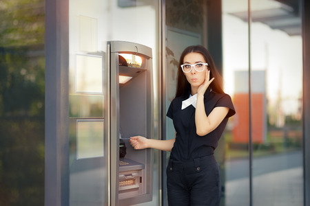 automatic teller machine bank: Stressed Woman with credit card at ATM