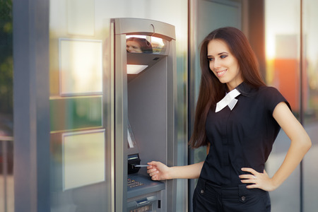 automatic teller machine bank: Woman with Credit Card at ATM cash machine Stock Photo