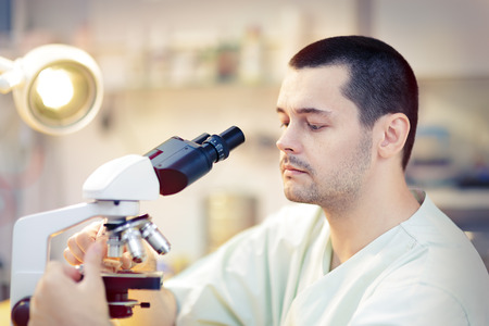 diagnostic tool: Young Male Scientist with Microscope Stock Photo