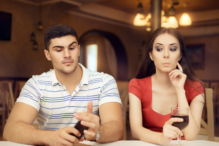 possessive: Curious Girl Spying Boyfriend on Smartphone