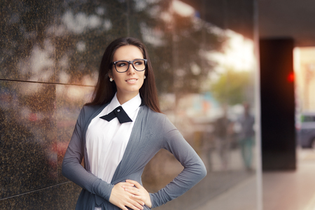 personable: Elegant Woman Wearing Glasses Standing Out in The City Stock Photo