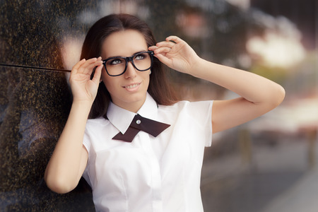 hair tie: Elegant Woman Wearing Glasses Standing Out in The City Stock Photo