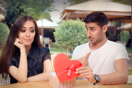materialist: Girl Disappointed on Her Valentine Gift From Boyfriend Stock Photo