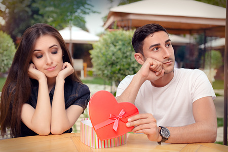 beautiful anniversary: Girl Disappointed on Her Valentine Gift From Boyfriend Stock Photo